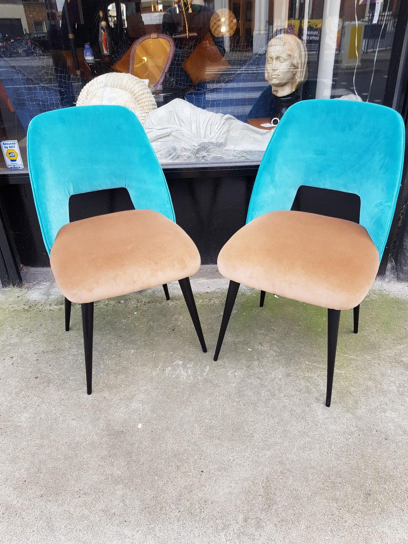 Pair of chairs in the style of Silvio Cavatorta